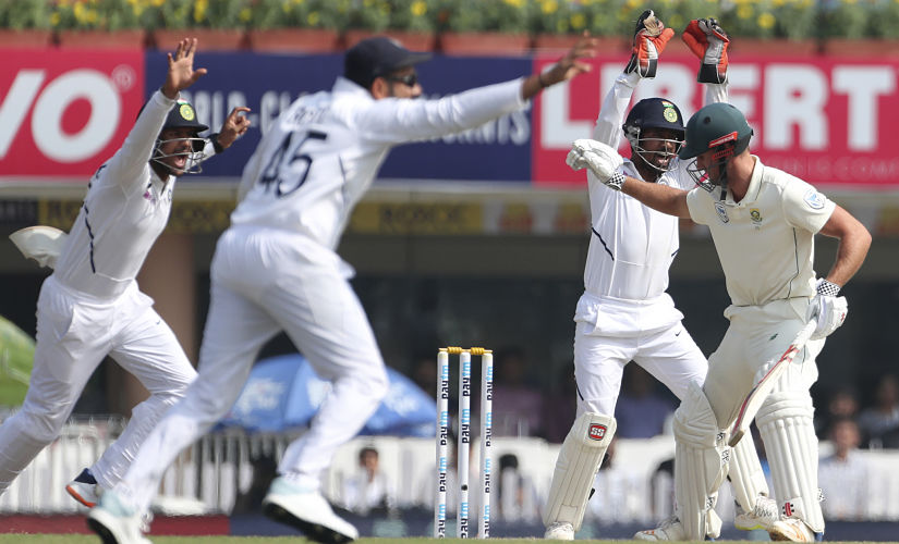 Indian players celebrate the dismissal of South Africa's Theunis de Bruyn, right, during the fourth day of Ranchi Test. AP