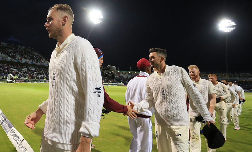 England bowler Stuart Broad (L) and England's James Anderson (C) leave the pitch with teammates after their win on day 3 of the first Test cricket match between England and the West Indies at Edgbaston in Birmingham, central England on August 19, 2017. - England hammered the West Indies by an innings and 209 runs as the inaugural day/night Test in Britain ended inside three days at Edgbaston on Saturday. (Photo by Lindsey PARNABY / AFP) / RESTRICTED TO EDITORIAL USE. NO ASSOCIATION WITH DIRECT COMPETITOR OF SPONSOR, PARTNER, OR SUPPLIER OF THE ECB
