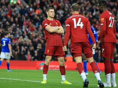 Premier League Late James Milner penalty takes Liverpool eight points clear in first place Tottenham rocked by Brighton