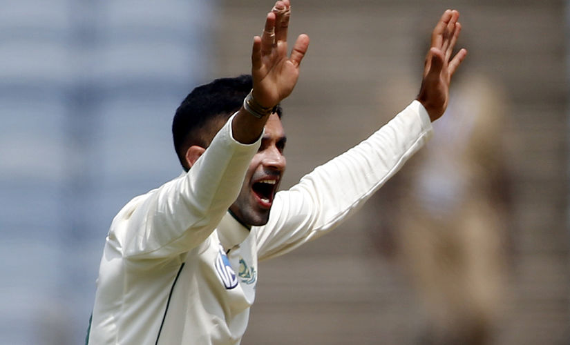 South Africa's cricketer Keshav Maharaj celebrates after dismissing India's Ajinkya Rahane's during the second day of the second cricket test match between India and South Africa in Pune, India, Friday, Oct. 11, 2019. (AP Photo/Rajanish Kakade)