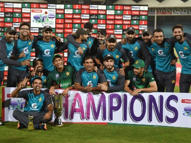 Pakistan's cricketers pose for a photograph with their trophy after winning the third and final one day international (ODI) cricket match between Pakistan and Sri Lanka. AFP