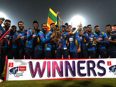 Sri Lankan players celebrate after winning the series. AFP