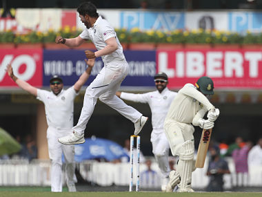 Umesh Yadav leaps in the air to celebrate the dismissal of South Africa's Quinton de Kock. AP