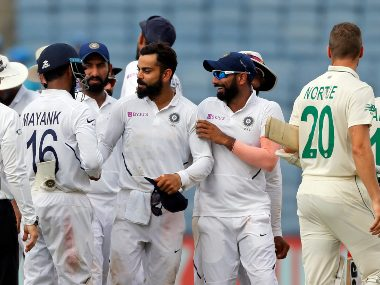 India captain Virat Kohli celebrates with teammates after winning the second Test against South Africa. AP