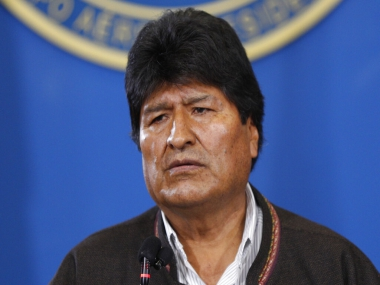 Bolivias interim president says new elections to be held soon amid violent unrest in country after resignation of Evo Morales