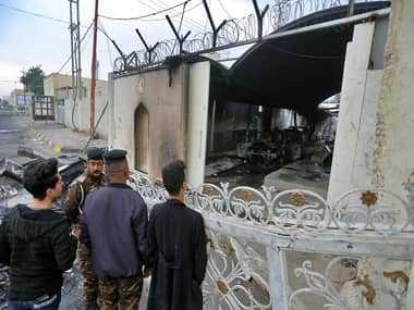 Iraqi forces shoot dead 14 protesters authorities impose curfew in aftermath of burning of Iranian consulate in Najaf