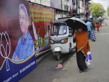 Sri Lankan presidential elections Former defence secretary Gotabaya Rajapaksa  takes early lead in polls with 5287 votes housing minister trails with 3967