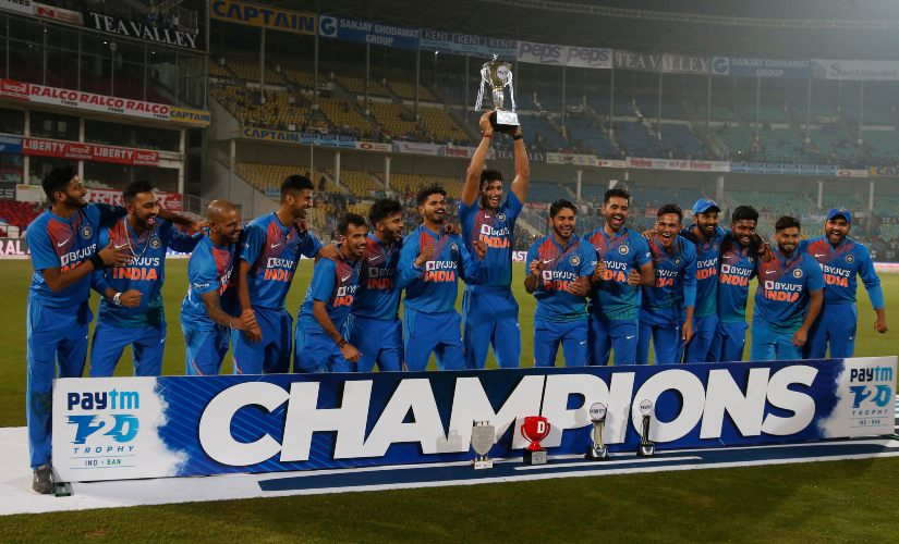 Indian players pose with the trophy after T20I series win over Bangladesh. AP