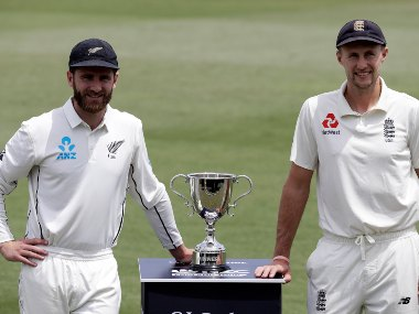 Kane Williamson (L) and Joe Root pose with the Test series trophy. AP