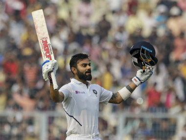 India's Virat Kohli raises his bat after scoring a century during the second day of the second Test between India and Bangladesh. AP
