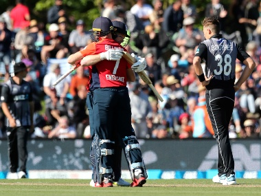 England's Eoin Morgan and Sam Billings celebrate after defeating New Zealand in their T20 cricket game at Hagley Oval, in Christchurch, New Zealand, Friday Nov.1, 2019. (Martin Hunter/Photosport via AP)