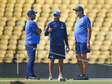 Indian captain Rohit Sharma inspects the Nagpur pitch with bowling coach Bharat Arun (L) and coach Ravi Shastri. PTI