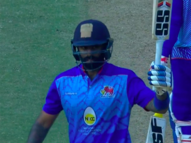 Suryakumar Yadav raises his bat after completing his fifty. Screengrab from BCCI.TV