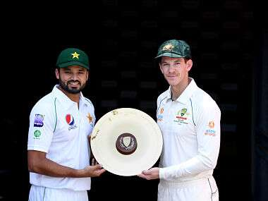 Pakistan captain Azhar Ali and his Australian counterpart Tim Paine pose for a photo ahead of the 1st Test between Australia and Pakistan at The Gabba. Getty