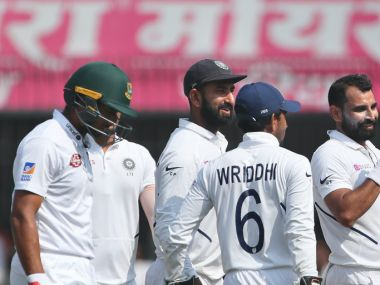 India's Mohammed Shami, third right, celebrates with teammates the dismissal of Bangladesh's Mahmudullah, left, during the third day of first cricket test match between India and Bangladesh in Indore, India, Saturday, Nov. 16, 2019. (AP Photo/Aijaz Rahi)