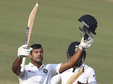 India's Mayank Agarwal raises his bat and helmet to celebrate scoring a double century during the second day of first cricket test match between India and Bangladesh in Indore, India, Friday, Nov. 15, 2019. (AP Photo/Aijaz Rahi)