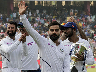India's captain Virat Kohli gestures to spectators as he leads his team in a victory lap after winning the second match and test series against Bangladesh in Kolkata, India, Sunday, Nov. 24, 2019. (AP Photo/Bikas Das)