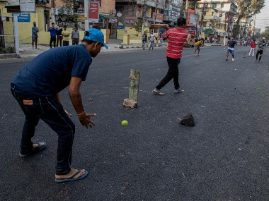 Indians play cricket as motor vehicles stay off the road during a shutdown protest against the Citizenship Amendment Bill (CAB) in Gauhati, India. AP