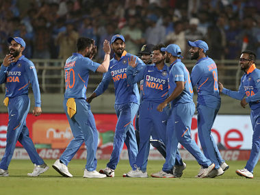 India's Kuldeep Yadav (centre) celebrates his hat-trick with teammates during the second ODI against West Indies in Visakhapatnam. AP Photo
