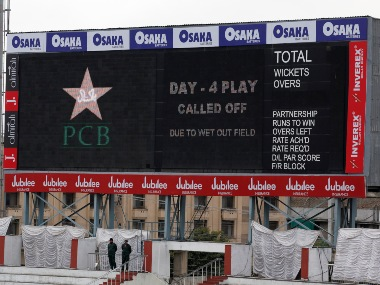 The scoring board at Pindi Cricket Stadium displayes massage match called off due to wet out field during the fourth-day of 1st Pakistan-Sri Lanka Test. AP