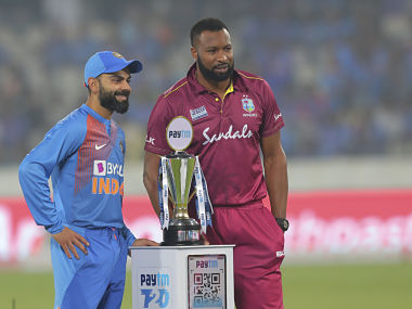 India's captain Virat Kohli, left, and West Indies' captain Kieron Pollard pose with the series trophy before the first Twenty20 international cricket match between India and West Indies in Hyderabad, India, Friday, Dec. 6, 2019. (AP Photo/Mahesh Kumar A.)