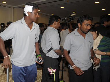 Sri Lankan cricketers Ajantha Mendis (left) and captain Mahela Jayawardene arrive in Colombo after escaping a terrorist attack outside Gaddafi Stadium in Pakistan in 2009. LAKRUWAN WANNIARACHCHI/AFP via Getty Images