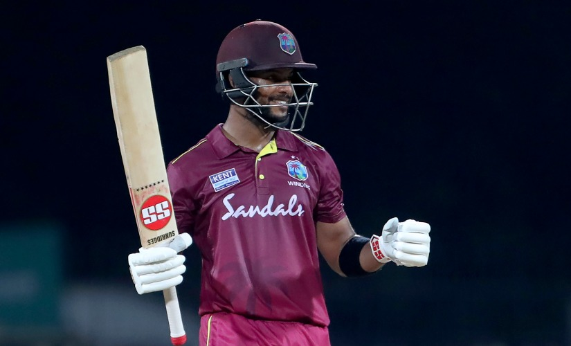 Shai Hope celebrates after completing his century against India in Chennai. AP