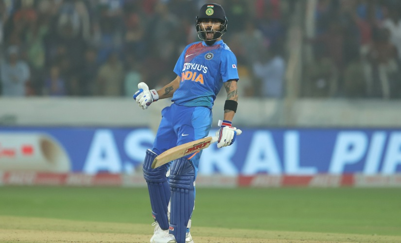 Virat Kohli celebrates after guiding India to victory over West Indies. Sportzpics