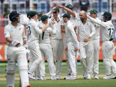 Australian players celebrate the wicket New Zealand's Colin de Grandhomme, left during play in their Test match in Melbourne, Australia. AP