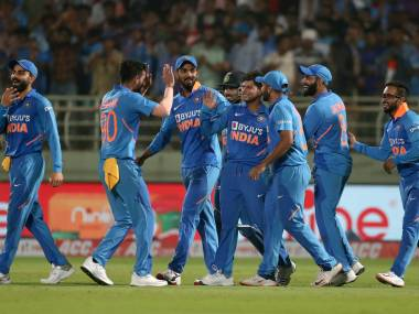 India's Kuldeep Yadav, center without cap, celebrates with teammates a hat-trick during the second one day international cricket match between India and West Indies in Visakhapatnam, India, Wednesday, Dec. 18, 2019. (AP Photo/Aijaz Rahi)