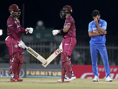 India's Deepak Chahar (right) reacts as West Indies' Shimron Hetmyer (left) and Shai Hope celebrate a boundary in Chennai, India on Sunday. AP Photo