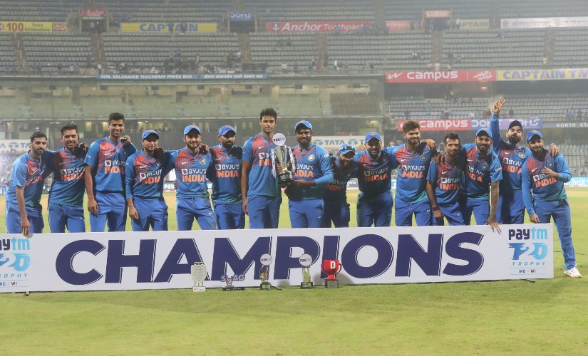 Indian team players pose with the trophy after winning the three-match T20I series against the West Indies 2-1. AP