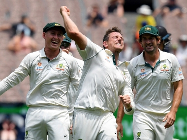 Australia's Marnus Labuschagne, left James Pattinson, centre and Australia's Joe Burns, right celebrate the wicket of New Zealand's Mitchell Santner during the second Test, in Melbourne, Australia. AP