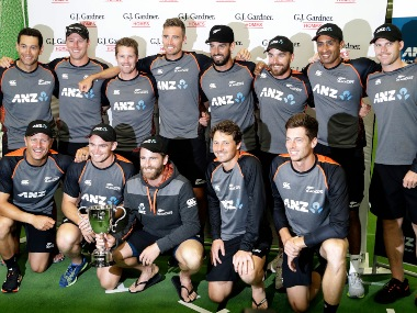 New Zealand cricket team poses with the trophy after winning the two-match Test series against England at home. AP