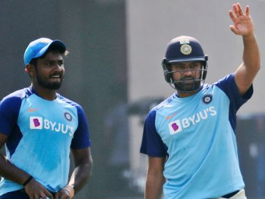 India's Rohit Sharma, right, gestures during a training session ahead of their third Twenty20 cricket match against West Indies in Mumbai, India, Tuesday, Dec. 10, 2019. (AP Photo/Rafiq Maqbool)