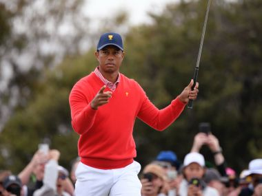 Tiger Woods Peyton Manning hold off late challenge to beat Phil Mickelson and Tom Brady in charity golf match