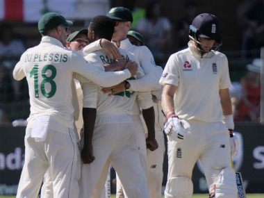 South Africans celebrate the dismissal of England captain Joe Root (R) on Day 1 of the third Test. AP