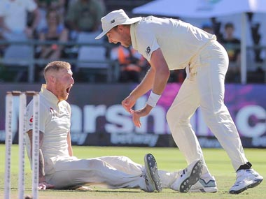 Ben Stokes, left, and Stuart Broad celebrate the wicket of Anrich Nortje during day five of the second Test between South Africa and England. AP