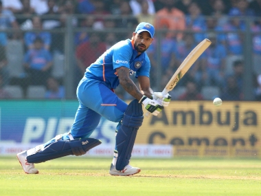 Shikhar Dhawan was hit on the rib cage by a Pat Cummins bouncer while batting in the second ODI. Sportzpics