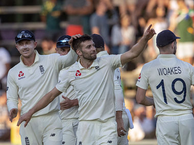 England's Mark Wood (middle) celebrates with teammates after dismissing South Africa's Anrich Nortje at the Wanderers. AP Photo