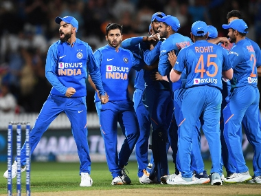Mohammed Shami is surround by his teammates after he successfully defended nine runs in the final over to take the game in tie-breaker. AP
