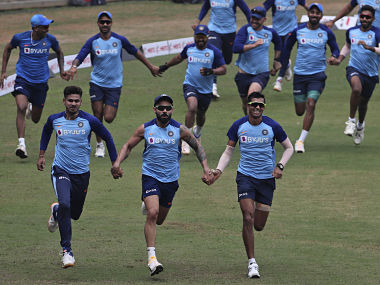 Virat Kohli and his other teammates during a training session. AP