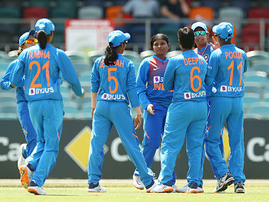 Rajeshwari Gayakwad celebrates with teammates after taking a wicket against England in the first match of the Tri-series. Getty