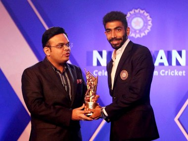 Jasprit Bumrah with the Polly Umrigar award. PTI