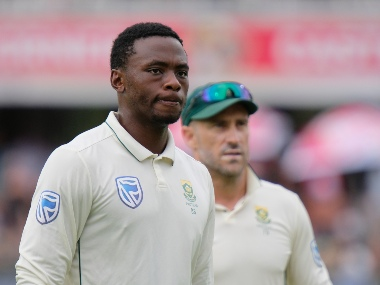 Kagiso Rabada of South Africa left and Faf du Plessis(C) of South Africa right leave the field after England are bowled out during day two of the third cricket test between South Africa and England in Port Elizabeth, South Africa, Friday, Jan. 17, 2020. (AP Photo/Michael Sheehan)