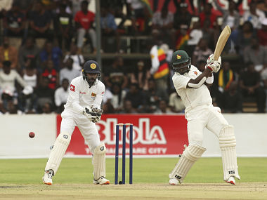 Zimbabwe batsman Kevin Kasuza, right, plays a shot during the test cricket match against Sri Lanka at Harare Sports Club, Sunday, Jan, 19, 2020. Zimbabwe won the toss and elected to bat in its first match since the International Cricket Council lifted the country's ban last year. (AP Photo/Tsvangirayi Mukwazhi)