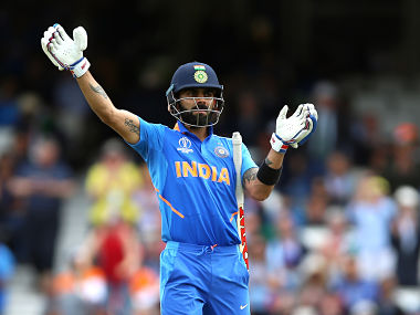 Virat Kohli gestures to the fans at The Oval to clap and applaud Steve Smith rather than have a go at him during the 2019 World Cup match against Australia. Getty