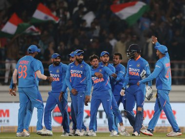 The Indian team celebrate the dismissal of Steve Smith four short of his ton in the second ODI in Rajkot. AP