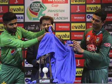 Pakistan captain Babar Azam (left) unveils the trophy with Bangladesh's Mahmudullah ahead of the T20 series. AP Photo