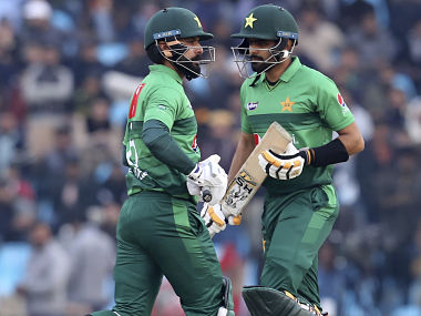 Pakistan batsmen Babar Azam, right, and Mohammad Hafeez run between the wicket during the second T20 cricket match against Bangladesh at Gaddafi stadium, in Lahore, Pakistan, Saturday, Jan. 25, 2020. (AP Photo/K.M. Chaudary)